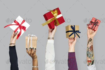 Diversity hands holding gifts