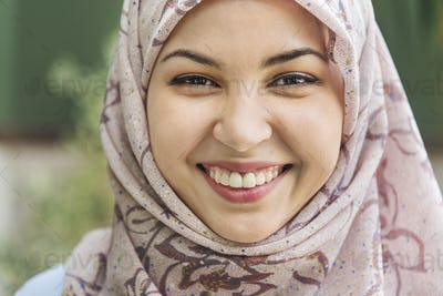 Close up face of Islamic woman smiling
