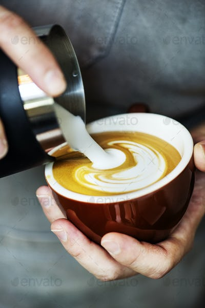 Closeup of barista making latte art