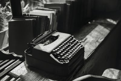 Closeup of retro typewriter on wooden table