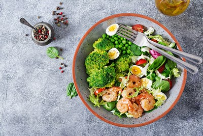 Fresh seafood recipe. Grilled shrimps and fresh vegetable salad, egg and broccoli.