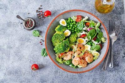 Grilled shrimps and fresh vegetable salad, egg and broccoli. Grilled prawns.