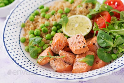 Healthy dinner. Slices of grilled salmon, quinoa, green peas, tomato, lime and lettuce leaves