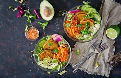 Fritter with lentils and radish, avocado, carrot salad.