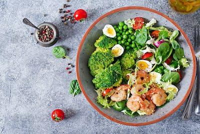 Grilled shrimps and fresh vegetable salad, egg and broccoli. Grilled prawns. Healthy food.