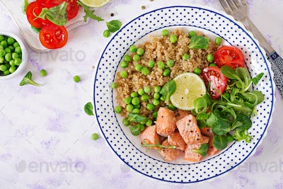 Slices of grilled salmon, quinoa, green peas, tomato, lime and lettuce leaves.