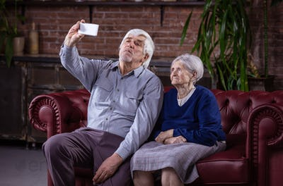 Senior couple taking selfie with smart phone