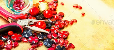 Making necklaces of glass beads.