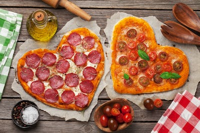 Heart shaped pizza with tomatoes and mozzarella and pepperoni