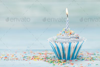 Sweet cupcake with candle