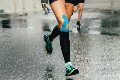 legs runner woman with kinesio tape