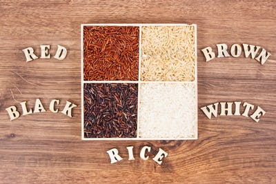 White, brown, black and red rice with inscription on board, healthy gluten free food concept