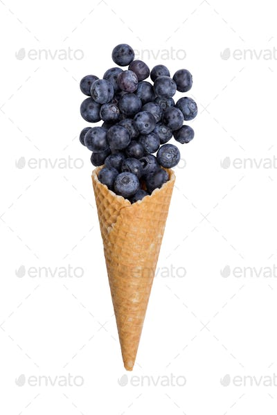 Waffle ice cream cone with fresh blueberry fruits
