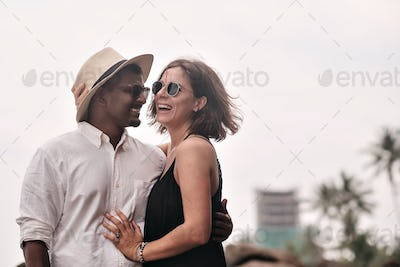 Lovely couple on tropical beach. Concept of just married lovers.