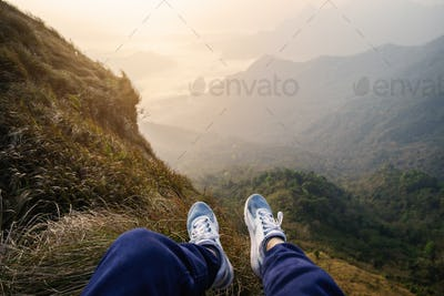 Traveler sitting and looking at view of nature