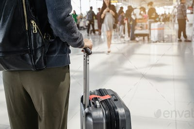 Young woman traveller walking in airport terminal hal