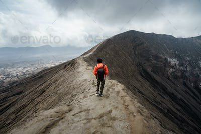 Traveler at crater volcano at Bromo (Gunung Bromo), Indonesia