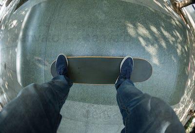 Skateboarding legs on ramp