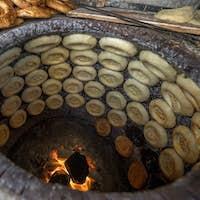 Making naan food in traditional stove,xingjiang,china