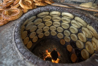 Making naan food in traditional stove,xingjiang,china