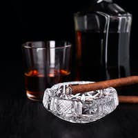 Glass of whiskey with smoking cigar. whisky, tobacco