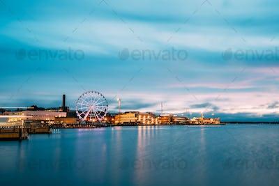 Helsinki, Finland. View Of Embankment With Ferris Wheel In Eveni