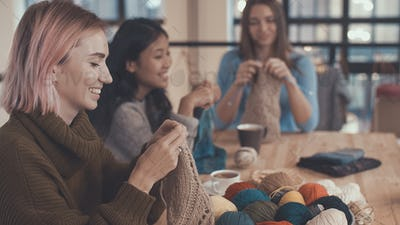 Girls with knitting needles