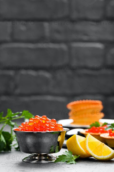 Red salmon fish caviar, salmon caviar in metal bowl. Caviar. Selective focus