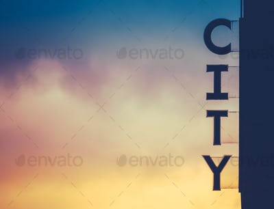 Urban City Sign At Sunset