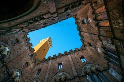 Siena landmark photo. Cortile del Podesta and Mangia tower. Tusc