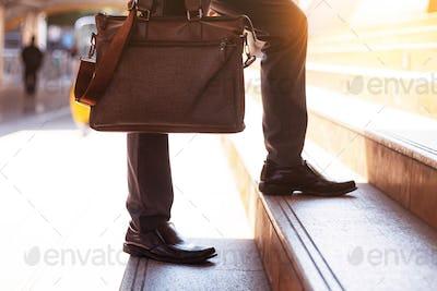 Businessman carrying a bag