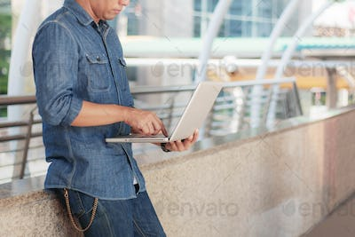 Young man holding notebook working