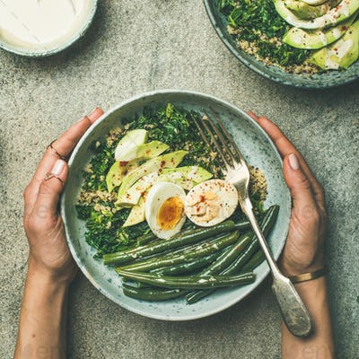 Quinoa, kale, green beans, avocado, egg bowls flat-lay, square crop