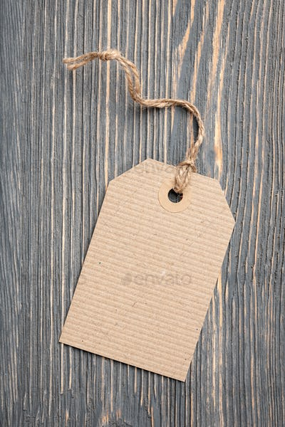 Paper tag on wooden background