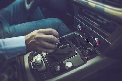 Men Driving the Car