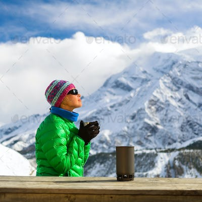 Woman drinking camping in mountains