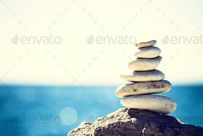 Stones balance, vintage pebbles stack background
