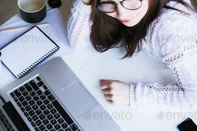 Girl using her laptop in her house.