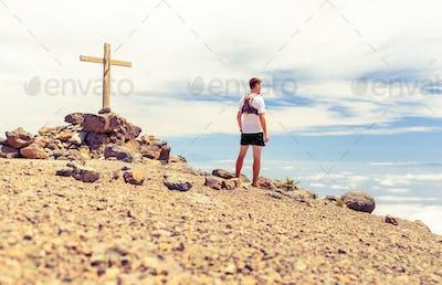 Trail runner summit, man running in mountains