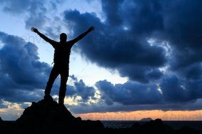 Happy winner reaching life goal success man