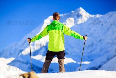 Man hiking in Himalaya Mountains in Nepal
