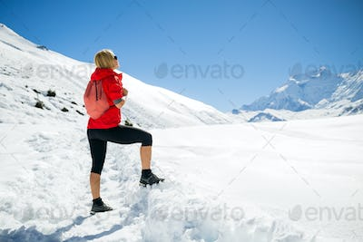 Woman hiker looking at inspirational landscape
