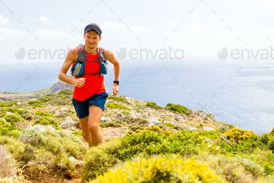 Mountain running man in inspirational landscape
