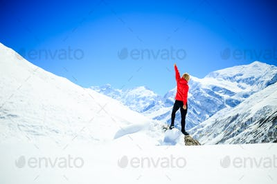 Woman success climbing on mountain peak