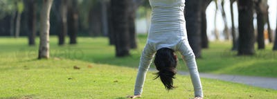 Handstand on grass in park