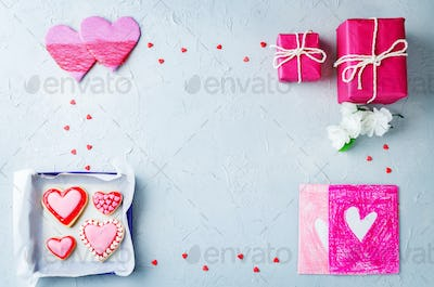 Grey background with Heart shape sugar cookies, gifts and cards