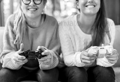 Women playing video game together