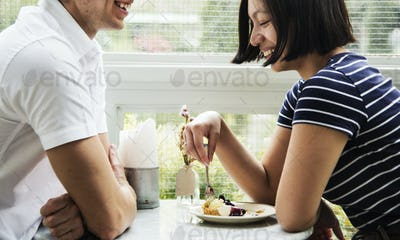 Couple dating in the cafe