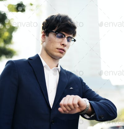 Business man looking at the watch