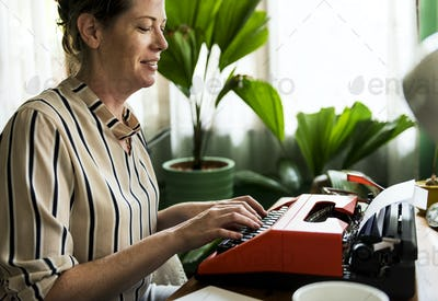 Woman typing on a retro typewriter